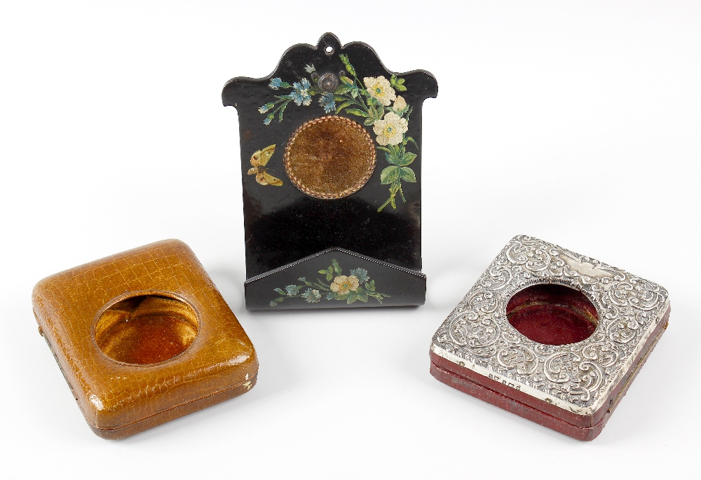 Lot 280 - Three pocket watch cases. The first, an easel style pocket watch case, the hinged opening front with