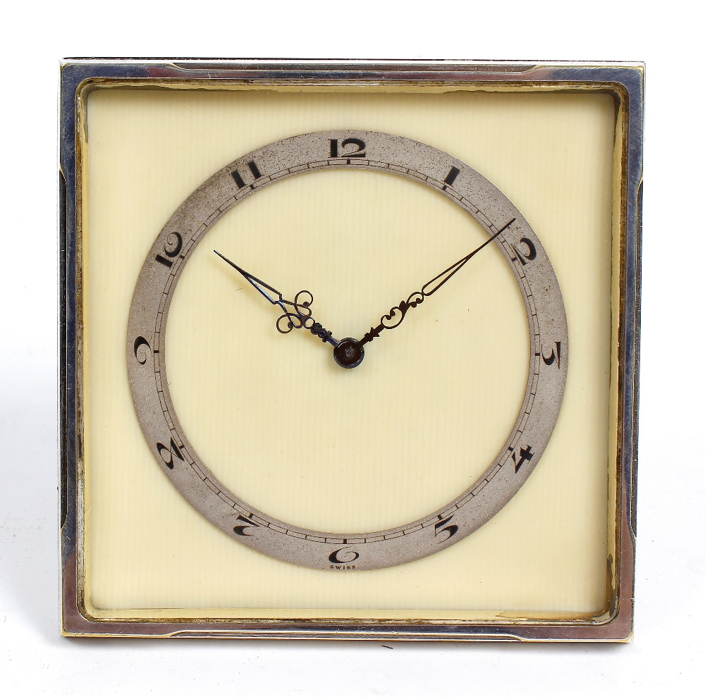 Lot 802 - A Swiss Art Deco desk timepiece. The 3-inch Arabic chapter ring and blued steel hands upon a cream