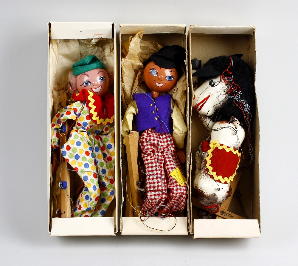 Lot 530 - Three boxed Pelham puppets Comprising 'Katie Clown', 'Dutch Boy' and a horse, in printed yellow card