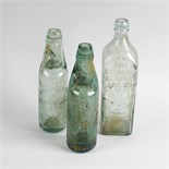 Two boxes containing a collection of assorted glass bottles Comprising a group relating to