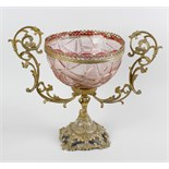 A coloured glass mounted centrepiece. The pink cut glass bowl having a lobed rim with plain and