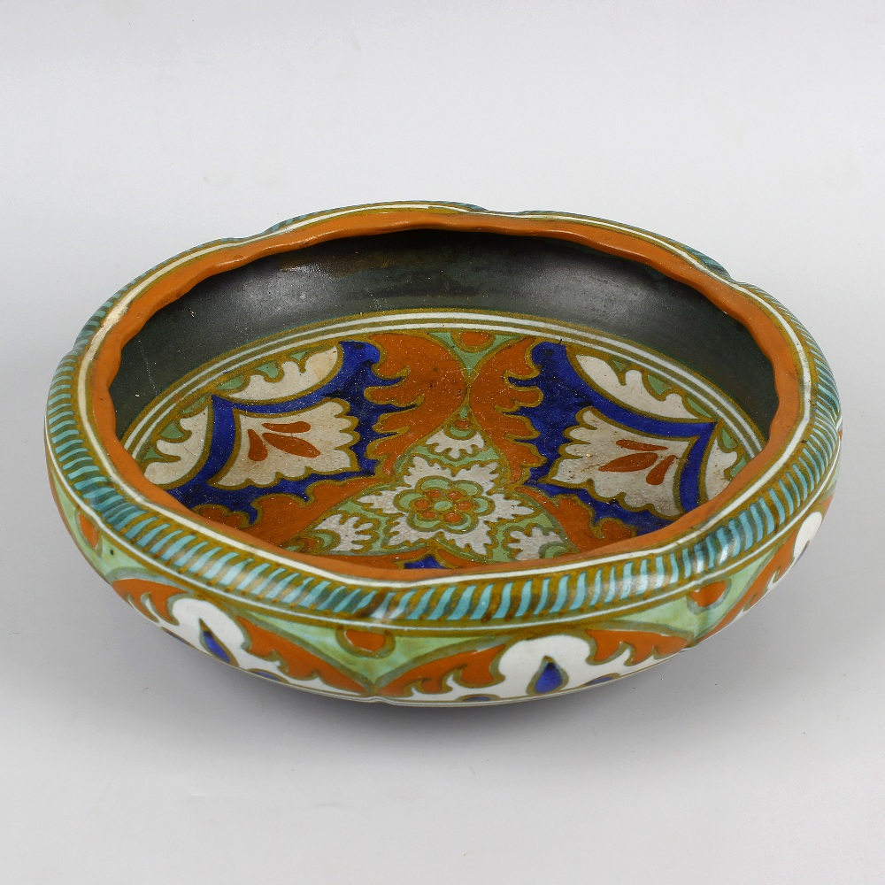 Lot 88 - A Gouda pottery bowl. Of slightly lobed form decorated in orange, blue and cream glaze, the whole