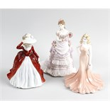 A group of Doulton, Coalport and Worcester figures. Comprising four Coalport ladies, including '