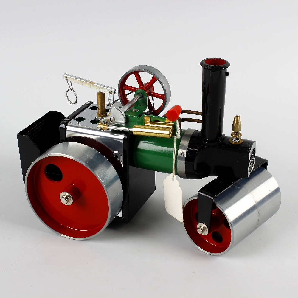 Lot 523 - A Mamod SR1 A live steam model steam roller in original box, together with a similar Mamod open