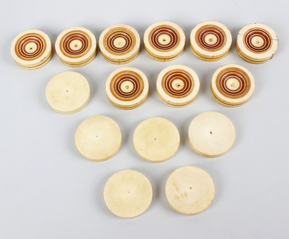 Lot 349 - A set of turned and stained ivory counters. Each of circular outline comprising six plain examples