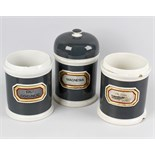 Seven late Victorian pottery apothecary jars, each of cylindrical form with dark green glazed