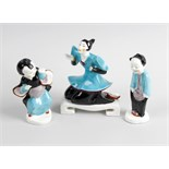 A group of three Royal Worcester Chinese figures, comprising a kneeling female number 3397, plus two