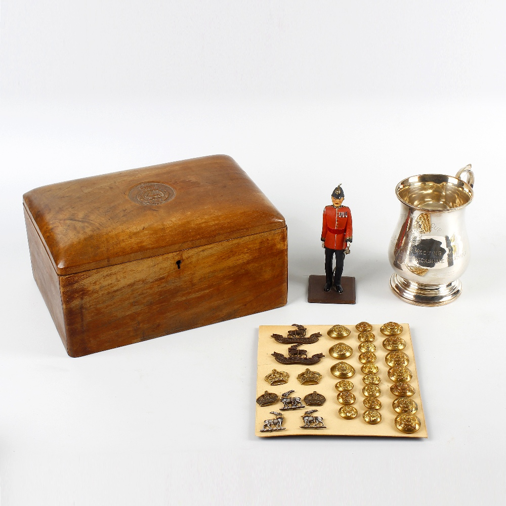 Lot 442 - A collection of Warwickshire Regiment memorabilia. Comprising: a walnut humidor or cigar box, the