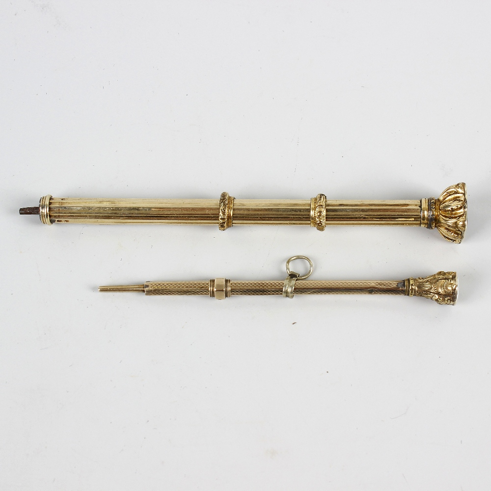Lot 231 - Two 19th century yellow metal propelling pencils. Each of facetted form with stone-set terminal,