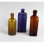 Two boxes containing a large collection of assorted glass bottles To include a box of amber examples