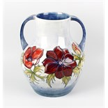 A large Moorcroft 'Anemone' pattern two-handled vase. Of bulbous form with tube-lined decoration