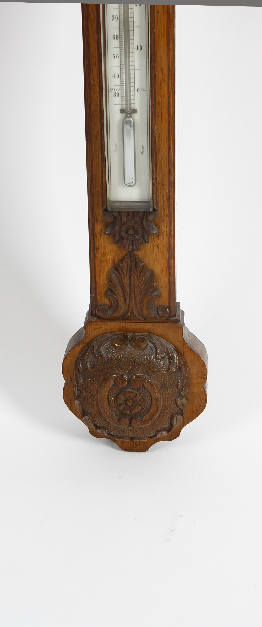 Lot 817 - A late Victorian carved oak stick barometer Hill, Birmingham The break-arched and flowerhead-
