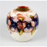 An unusual Walter Moorcroft 'Pansy' pattern vase Circa 1950, of ovoid form, with tube-lined