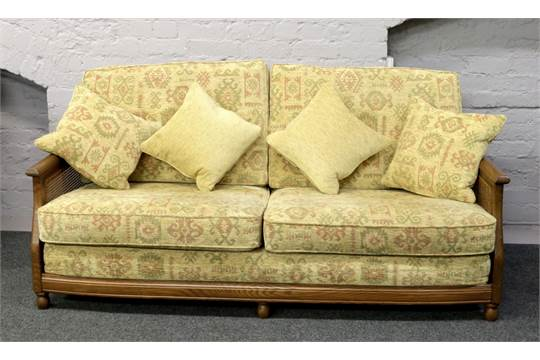 An Ercol Bergere Three Piece Suite Consisting Of Two Seat Sofa