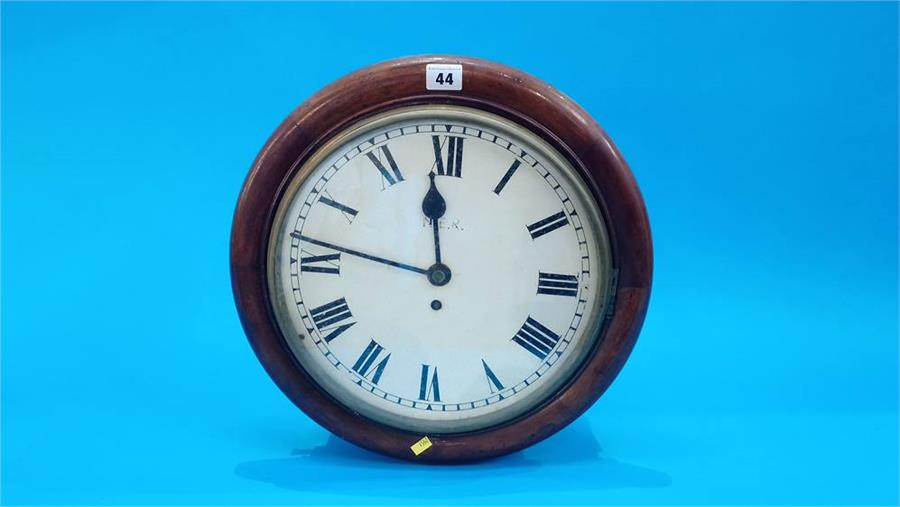 Lot 44 - A North Eastern Railway mahogany cased wall clock. Dial 30.5cm diameter