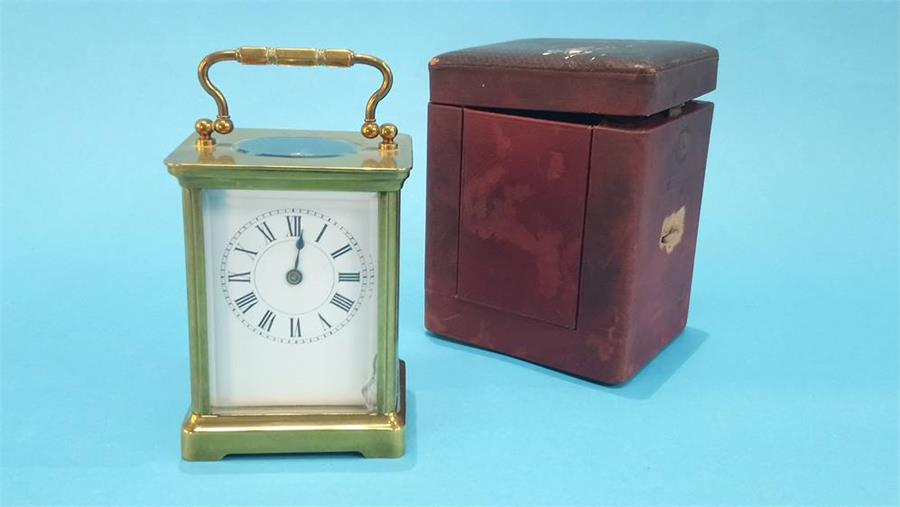 Lot 38 - A small brass carriage clock and leather case. 10.5cm high