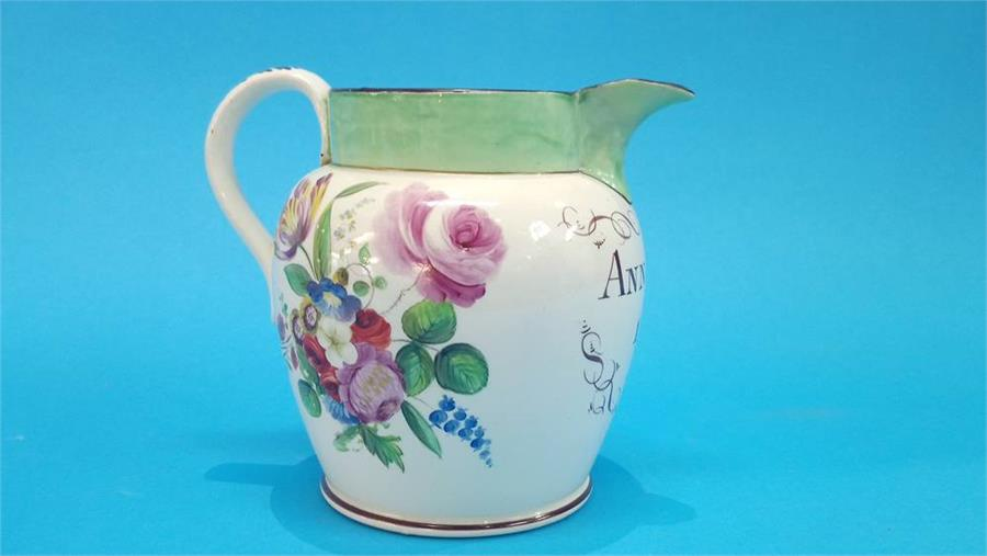 Lot 37 - A 19th Century Sunderland jug, to Ann Owens, dated 1824, decorated with flowers. 15cm high
