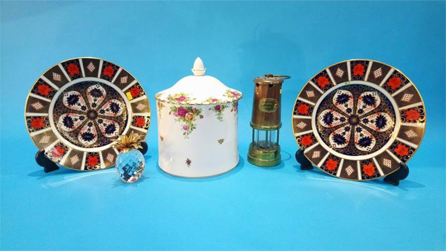 Lot 109 - A Swarovski pineapple, a Miners lamp, two Royal Crown Derby plates etc.