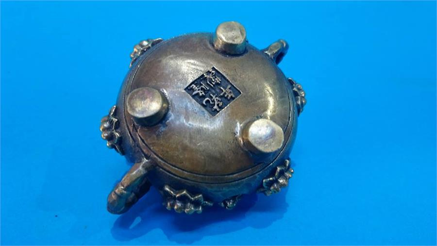 Lot 29 - A small Chinese bronze censor, with seal mark to base. 5 cm high 9 cm diameter