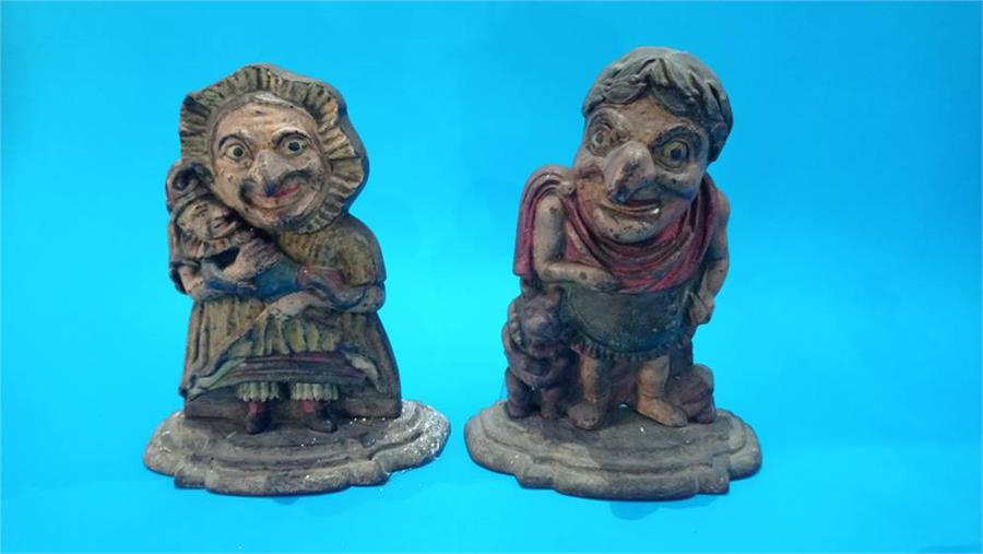 Lot 117 - A pair of Victorian cast iron Punch and Judy doorstops.