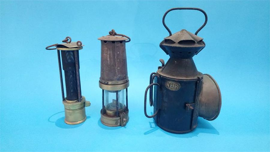 Lot 120 - An NER lamp and two Miner's lamps.