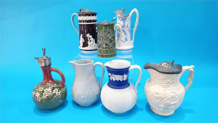 Lot 93 - Seven various Victorian water jugs.