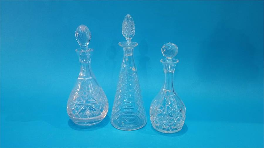 Lot 72 - Three cut glass decanters.