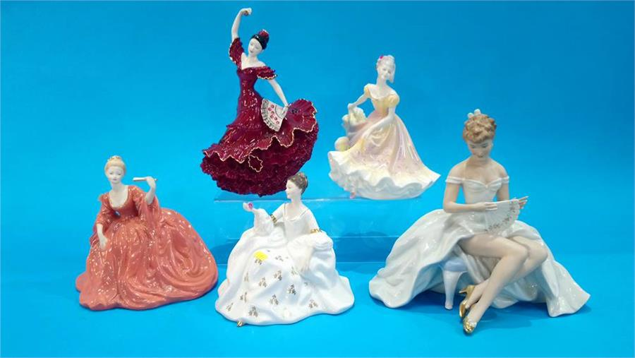 Lot 98 - A German porcelain ballerina figure and three Royal Doulton figurines of Ladies and a Coalport