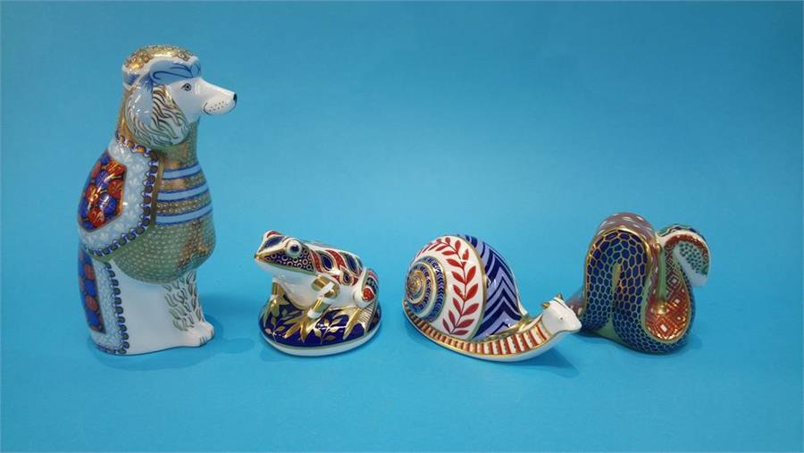Lot 35 - Four Royal Crown Derby paperweights to include 'French Poodle', 'Frog', 'Snail' and 'Snake'.