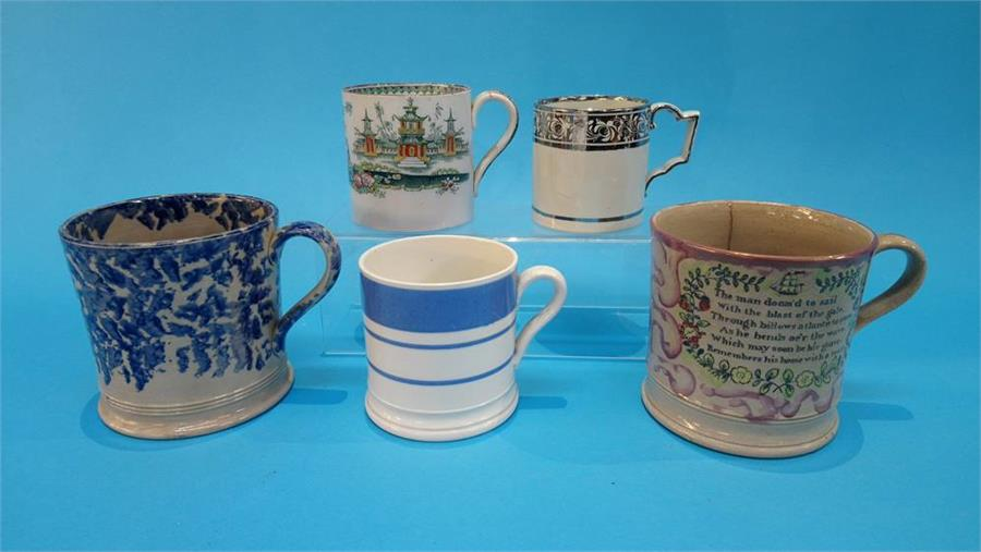 Lot 81 - A Sunderland pink lustre tankard and four various Victorian tankards. (5)
