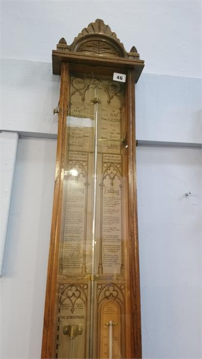 Lot 46 - A carved oak Admiral Fitzroy's barometer. 110cm long