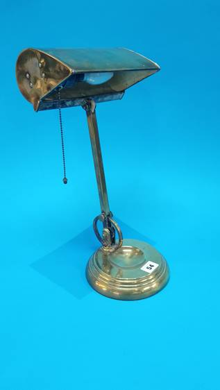 Lot 54 - A brass desk lamp with pull switch.