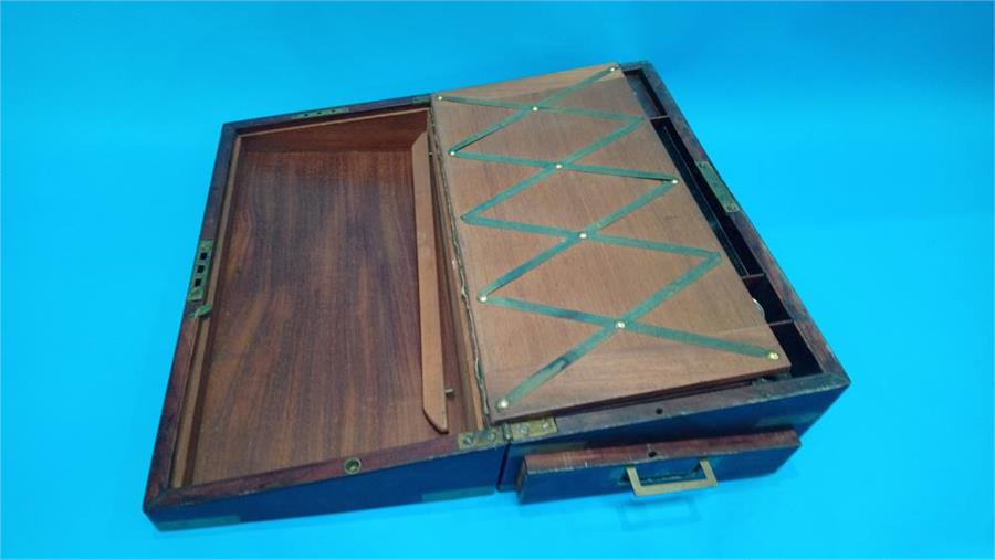 Lot 19 - A 19th Century Campaign style mahogany and brass bound writing slope. 46cm long