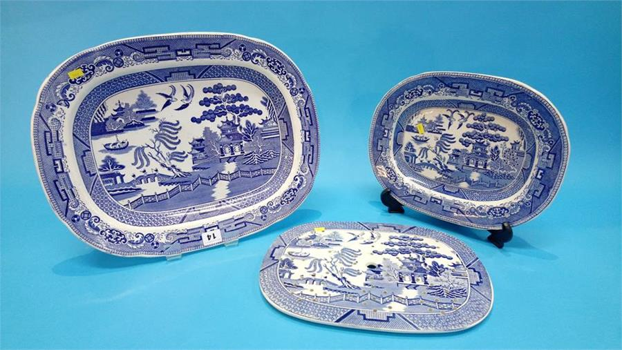 Lot 14 - Four blue and white meat plates and a strainer dish.