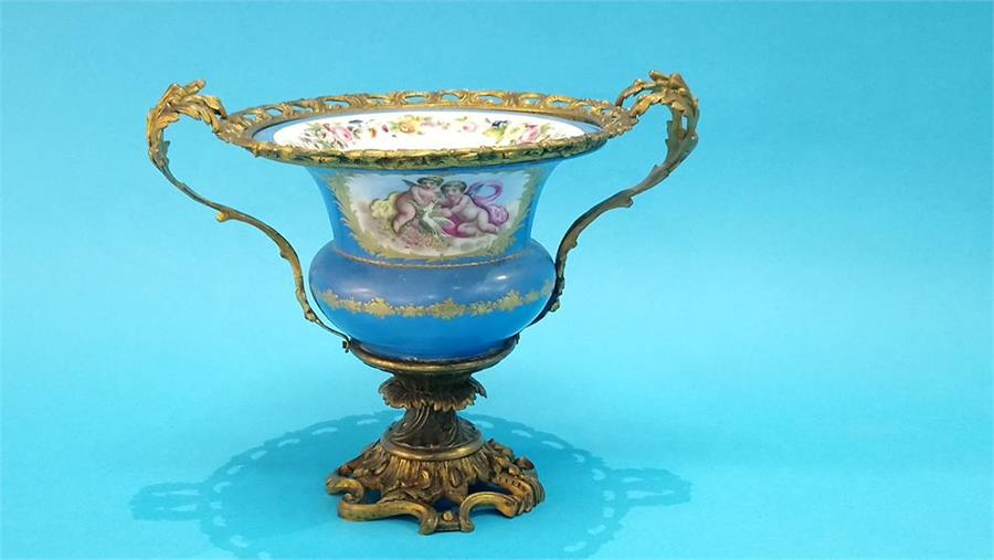 Lot 75 - A Continental Sevres style vase on a gilt metal ornate mount. 25cm high 35cm wide