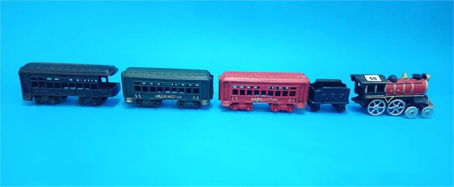 Lot 50 - A modern cast iron train set.