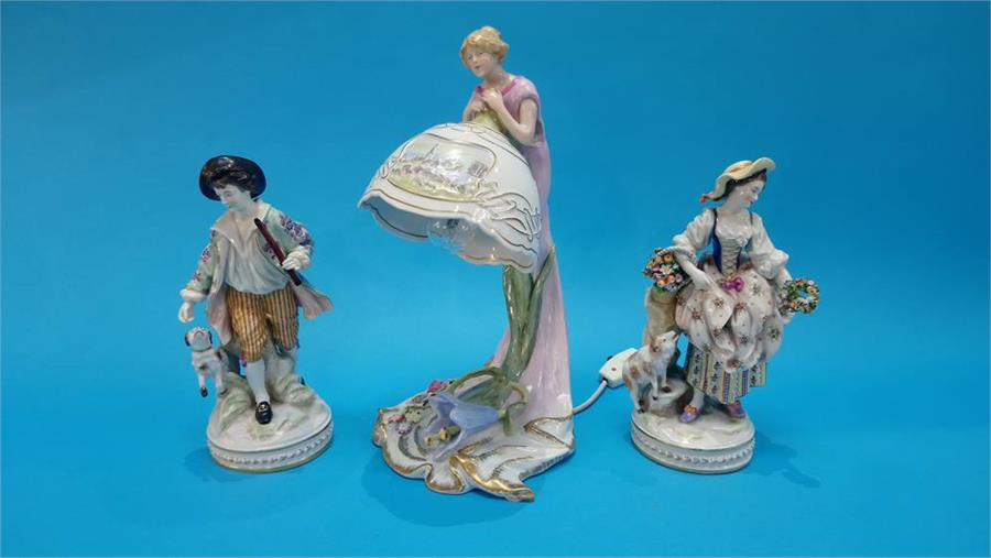 Lot 79 - A pair of Continental porcelain figures of a gallant and a lady, blue marks in underglaze blue and a