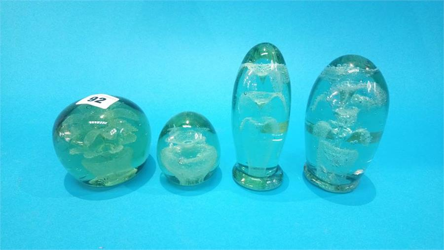 Lot 92 - Four Victorian green glass 'flower' dumps.