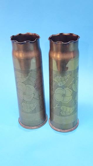 Lot 60 - A pair of floral engraved brass shell cases.