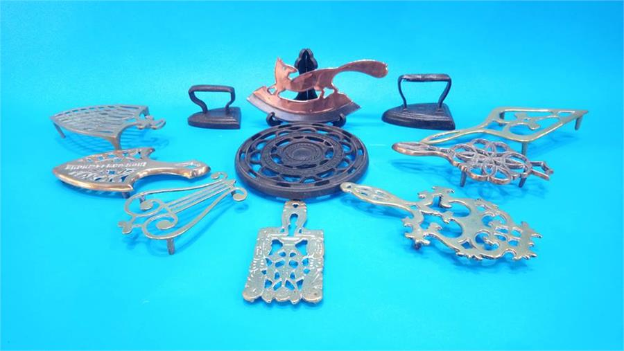Lot 53 - Seven various brass trivets, two irons etc.