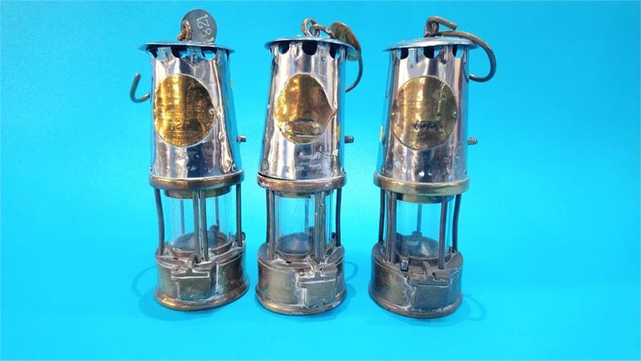 Lot 82 - Three Miners lamps.
