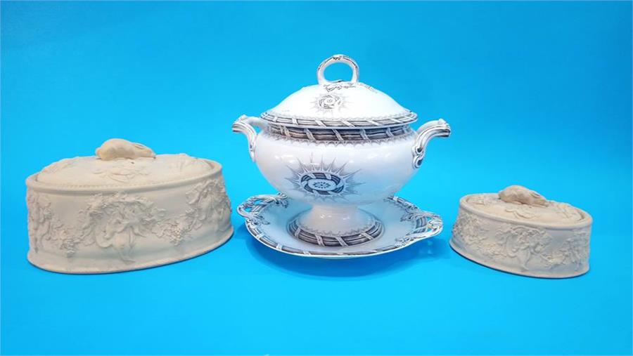 Lot 23 - A Victorian soup tureen and stand and two oval game pie dishes. (3)