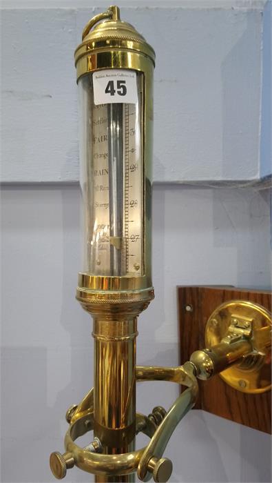 Lot 45 - An R.N. Desterro Lisbon brass marine barometer. 94cm high