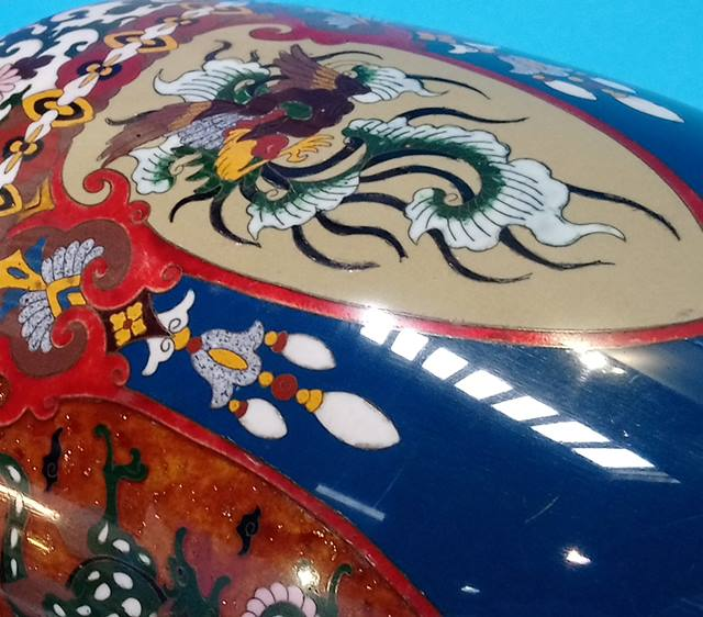 Lot 7 - A large Japanese Cloisonné vase, decorated with panels of birds and dragons on a blue ground. 46cm