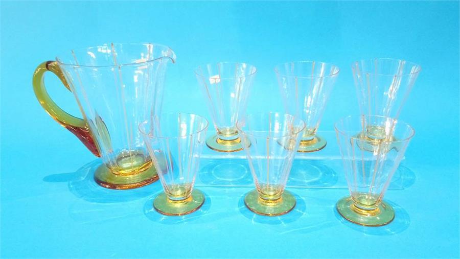 Lot 103 - A seven piece glass juice set.