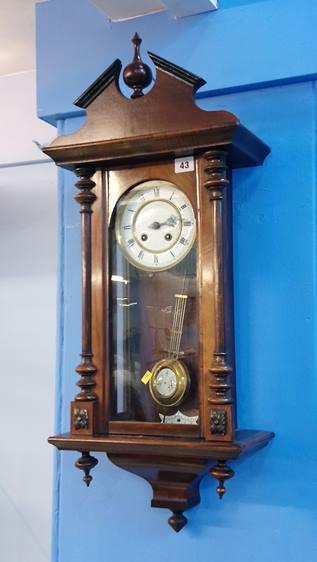 Lot 43 - A walnut wall clock.