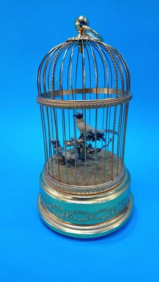 Lot 110 - A Reuge Music Saint Croix clockwork automaton of two birds in a birdcage. 28cm high