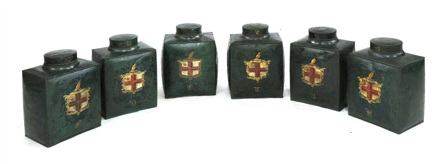 A SET OF SIX BOMBÉ-SHAPED TOLEWARE TEA CANISTERS,