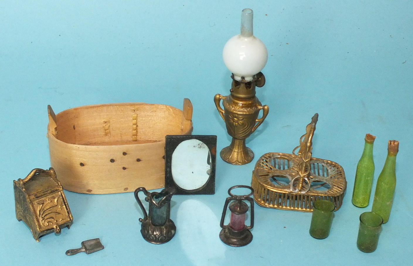 Lot 458 - An Edwardian doll's house oil lamp with gilt metal urn base and glass chimney, a gilt metal coal