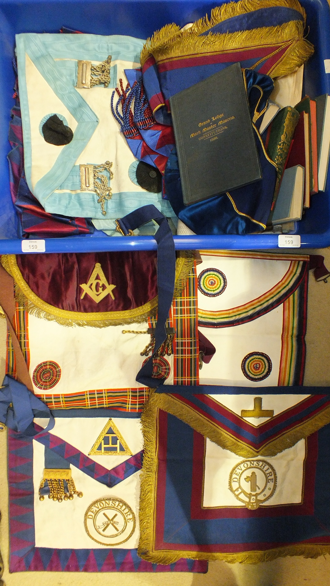 Lot 159 - A collection of aprons, collars and Masonic ritual and constitution books, (all in soiled